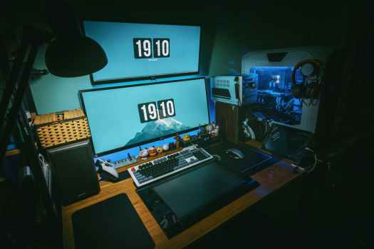 low light photography of computer gaming rig set